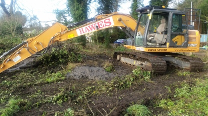 Levelling the surrounding land to provide drainage and increase natural light.