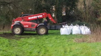 Using the telehandler to deliver the 15 cubic metres of gravel destined for the stream channel.