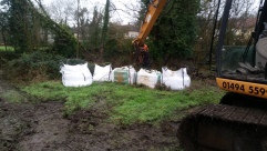 Using the 13 ton 360 tracked excavator to deliver the 15 cubic metres of gravel into the stream channel.