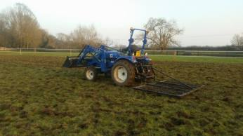 Chain harrowing equine paddocks.