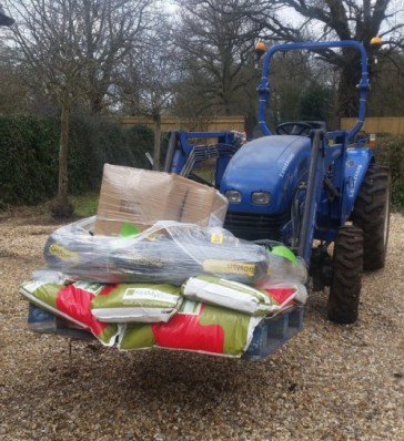 Loading up grass seed and fertiliser to reseed and feed equine paddocks.