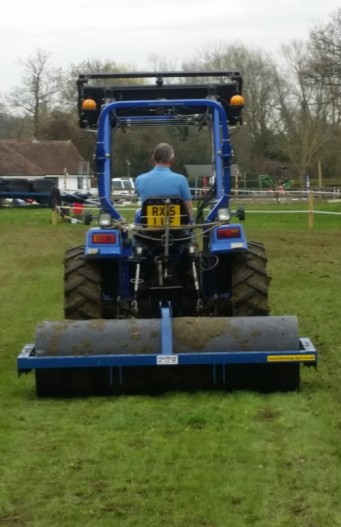 Rolling reseeded areas of equine paddocks.