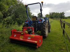 1.6m Grass Flail and 45hp Compact Tractor cutting horse gallops on site.