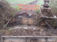 Removing the existing damaged timber bridge with the 8t 360 tracked excavator.