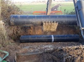 6m lengths of 600mm I/D twin wall culvert pipe being installed.