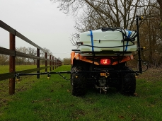 Spraying equine gallops with the quad-mounted 3m herbicide boom sprayer.