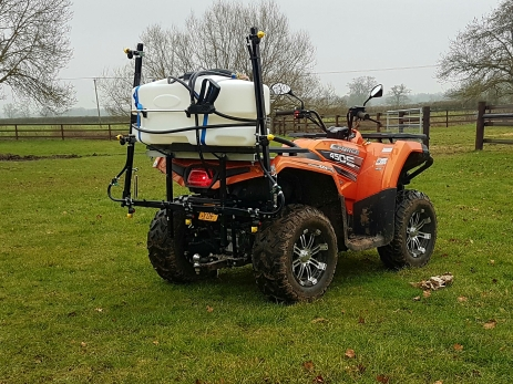 Off on site with the quad-mounted 3m herbicide boom sprayer.